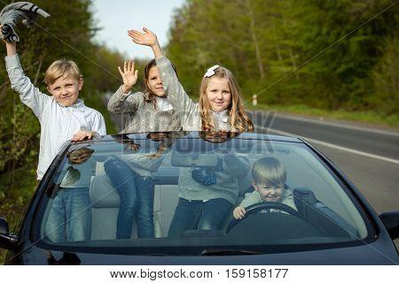 Happy Children Friends In Car