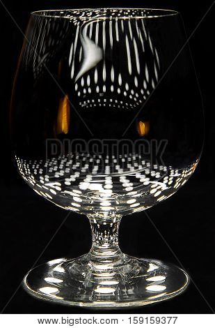 Small brandy snifter (three inches high) with light reflections