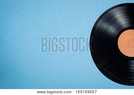 Vinyl Musical Disc On Blue Background;