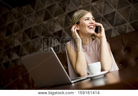 Young Freelance Woman In Cafe