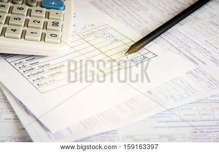 Utility bill with calculator and pencil Save money concept filter color style