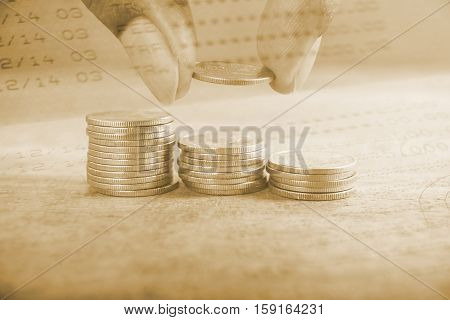 Double exposure hand with stack of coins and account bank or bank book and account banking for finance concept, Money and saving and finance concept