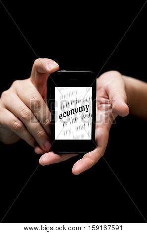 Hands Holding Smartphone, Showing  The Word Economy Printed