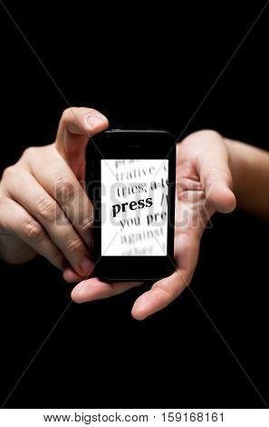 Hands Holding Smartphone, Showing The Word Press  Printed