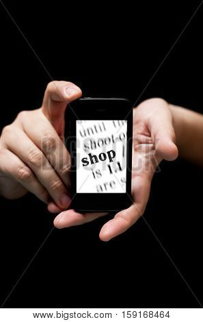 Hands Holding Smartphone, Showing  The Word Shop Printed