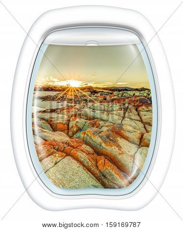 Plane window on Bay of Fires, east coast of Tasmania in Australia, from a plane through the porthole. Copy space.