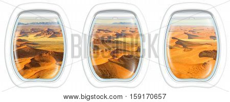 Three plane windows on Dead Valley, Sossusvlei desert in Namib Naukluft National Park, Namibia, from a plane on the porthole windows. Copy space.