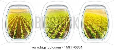 Plane windows on Napa Valley at sunset, California, United States, from a plane through the porthole window. Copy space.