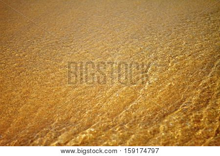 Golden sand on beach with sunshine warm morning and pattern background
