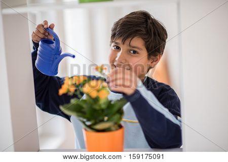 Kid planting flower