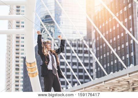 Middle-aged Engineer Or Architect Woman In Winner And Success In Bussiness. Middle-aged Women Profes