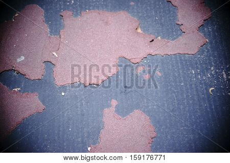 The close-up and top view on torn flooring.
