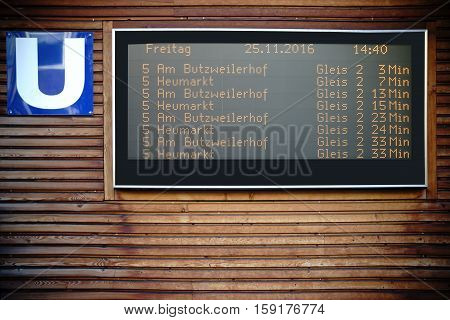 A digital display panel with the departure times for the subway in Cologne.