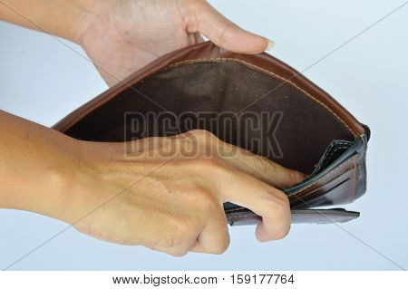 hand try to pick money in wallet but empty
