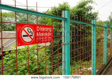 no-smoking sign in fence indonesia java jakarta