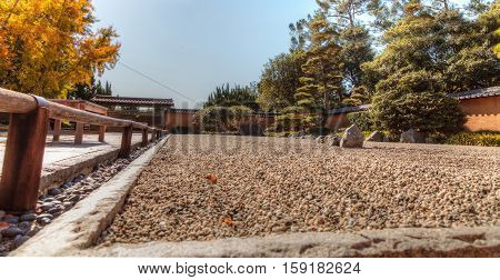 Los Angeles, CA, USA - November 25, 2016: Japanese zen garden raked pebbles in the Japanese garden at the Huntington Botanical Gardens in Los Angeles, California. Editorial use.