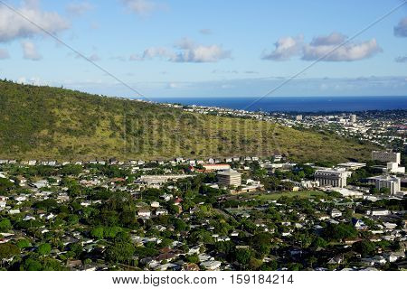 Manoa Valley on the Island of Oahu. Featuring Mountains High School College campus houses school and graveyard.