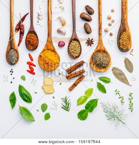 Various Herbs And Spices In Wooden Spoons. Flat Lay Of Spices Ingredients Chilli ,pepper, Garlic,dri