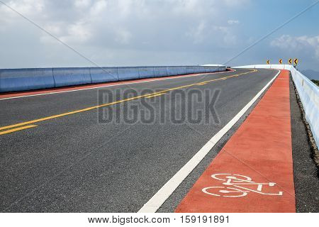 road with bicycle lane on bridge over the river