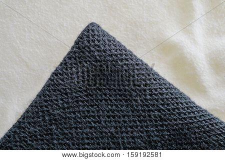 black fabric textile on cream fiber fabric. fabric uneven