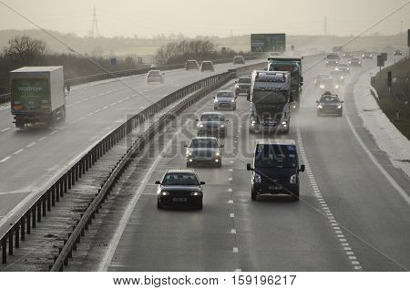 BEDFORD, UK - February 12, 2014: Hazardous conditions on the busy A421 near Bedford England UK this afternoon as high winds from a large Atlantic storm caused travel chaos on Britain's roads.