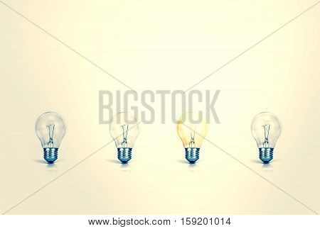 Outstanding creative idea background concept . one Light bulb glowing among a group light bulbs.vintage color tone