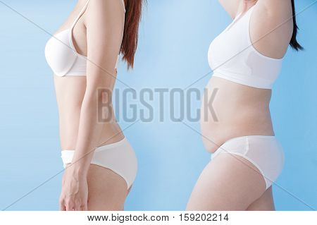 fat overweight woman and slim woman isolated on blue background asian