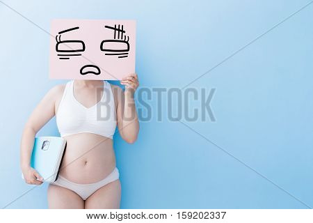 Fat overweight woman take tired billboard and Body weight with blue background asian