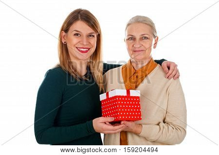 Picture of a beautiful young girl spending Christmas-time with her mother