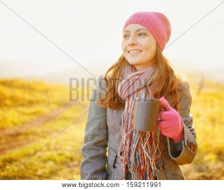 Young Pretty Woman With Coffee Mug In Hand Enjoying Fall Season