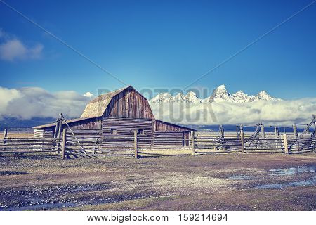 Vintage Toned Teton Mountain Range With Moulton Barn In The Grand Teton National Park, Wyoming, Usa.
