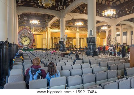 Tokyo, Tsukiji Japan - NOV 18, 2016 : Amida Buddha is enshrined within the central altar in the Main Worship Hall in the Tsukiji Honganji Temple