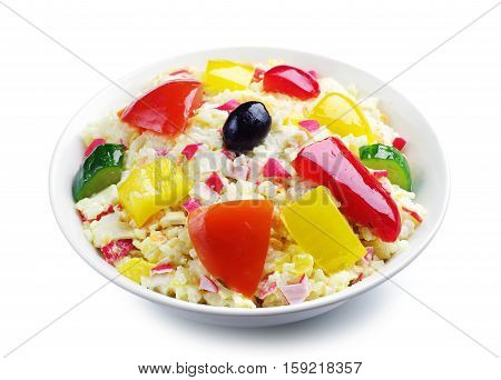 Salad with crab sticks rice and vegetables on white