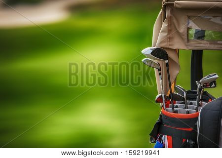 Golf Clubs Drivers Over Green Field