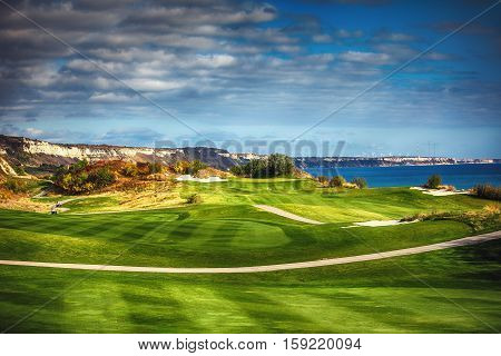 Golf course in the countryside near the sea
