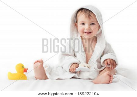 Little baby smiling under a white towel