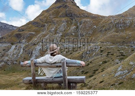 Back View Of Young Lady With Hat And Warm Poncho On Mountain Landscape, Durmitor, Montenegro