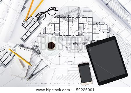 Construction Plans With Tablet, Smartphone And Drawing Tools On Blueprints