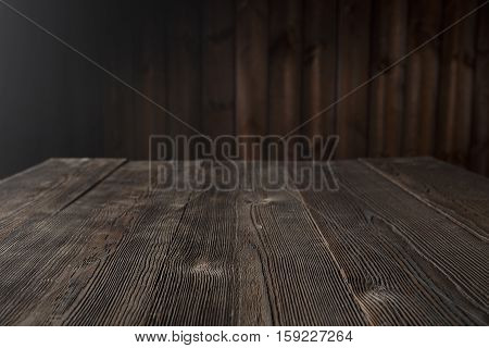 Dark wood background brown color. Close up of wall made of wooden planks
