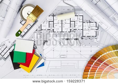 Construction Plans With Whitewashing Tools And Colors Palette On Blueprints