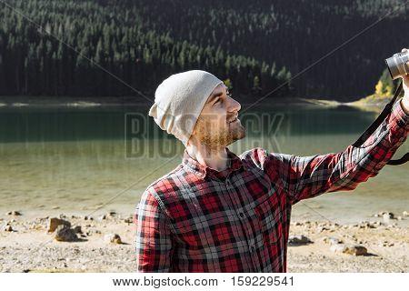 Handsome Traveler Taking Photo At The Black Lake, Montenegro