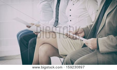 recruitment recruiting hire recruit hiring recruiter interview employment job exam room stress stressful position young group formal work chair corporation sitting diversity concept - stock image