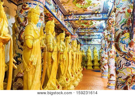 Golden Buddha Statues Along The Wall In The Interior Of The Linh Phuoc Pagoda In Da Lat City