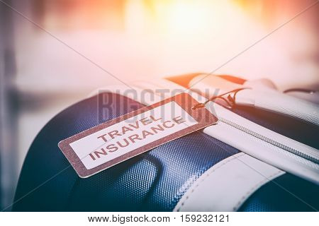 traveler travel insurance tag bag safe suitcase journey concept - stock image