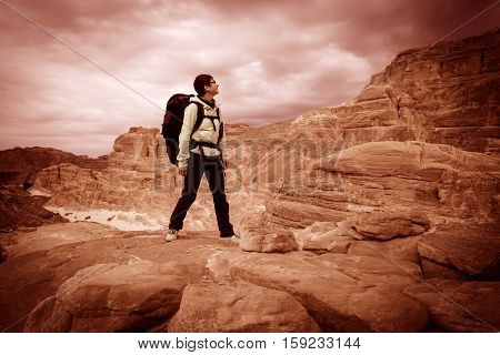 Woman mountain Hiker with backpack enjoy view in Sinai desert