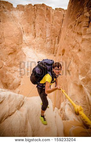 Sport girl climbing in canyon, Sinai, Egypt