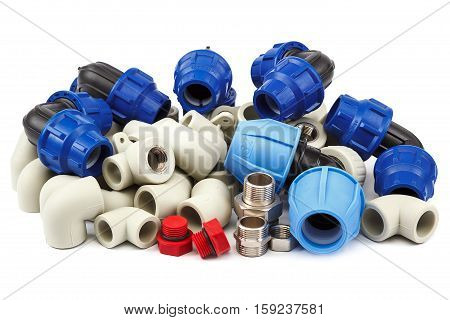 Set of metal-plastic plumbing couplings adapters plugs isolated on white background.