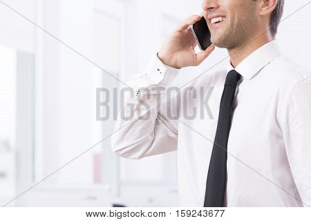 Smiling Young Businessman On The Phone