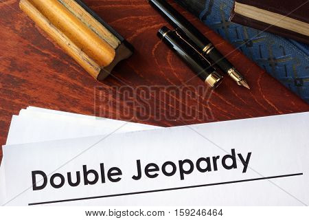 Papers with title Double Jeopardy on a table.