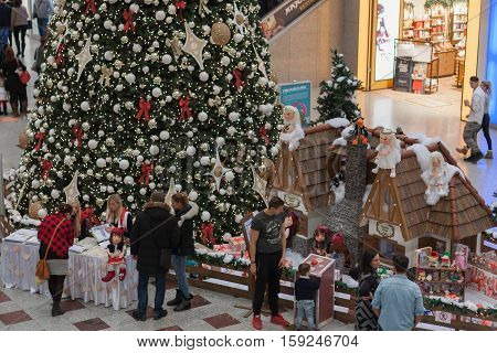 BRNO,CZECH REPUBLIC-NOVEMBER 19,2016:Christmas tree with decorations and walking people at shopping center Olympia on November 19 ,2016 Brno Czech Republic